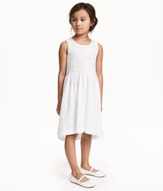 Check this out! Sleeveless dress in soft slub cotton jersey. Bodice with lace-covered front section. Seam at waist and gathered skirt. Slightly longer at back. - Visit hm.com to see more.