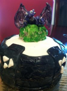 Skylanders Cake!  Cynder on top of the portal cake skylanders