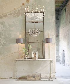 Gorgeous Entryway. Love the Vintage Mirror, Chandalier, console table, lamps, rustic walls, etc. - BEAUTIFUL