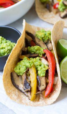 These Vegetarian Portobello Mushroom Fajitas are a 30 minute meal that you can prep ahead. With guacamole, these healthy vegan fajitas are hard to resist!   www.kristineskitchenblog.com