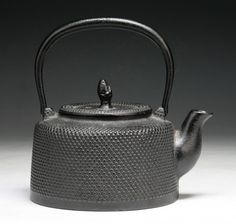 An Antique Japanese Iron Teapot.