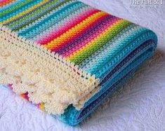 With this pattern by TheHatandl you will lear how to knit a Crochet Blanket PATTERN - Crayon Box Blanket step by step. It is an easy tutorial about rainbow to knit with crochet or tricot. Crochet Afghans, Crochet Motifs, Crochet Flower Patterns, Baby Blanket Crochet, Crochet Baby, Crochet Kits, Crochet Unicorn, Scarf Crochet, Tunisian Crochet