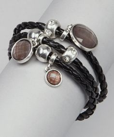 Timeless glam gets a contemporary edge with this chic charm bracelet. Luxe woven leather and multi-faceted glass beads add elegance and sophistication to any ensemble.0.75'' W x 7.75'' LBase metal / leather / glassImported