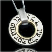 This unique handcrafted Kabbalah pendant is made of sterling silver, the inner ring is made of 9 K Gold. Both sides of the pendant are engraved with a three-letter combination in Hebrew that spells one of the 72 names of God along with the corresponding psalms from Kabbablist texts.