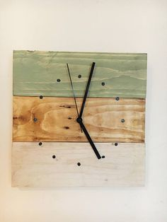 This clock is lovingly handcrafted from reclaimed wood and fitted with a quartz clock mechanism. We paint two slats of the clock in chalk paint and leave the third in natural wood. We then lightly sand the whole clock by hand, so the grain of the wood starts to appear beneath the