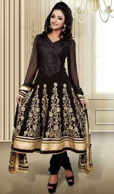 Trendy Black Embroidered Georgette Anarkali Suit Daunt your admirers with your charm with this trendy black embroidered georgette Anarkali suit. This attire is nicely designed with floral patch, resham and stones work. #GeorgetteAnarkaliSuit #PartyWearChuridarSuits