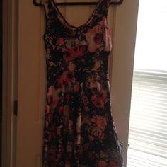 Flower/skull print hot topic dress Silky flower/skull print dress wore twice. Hot Topic Dresses Mini