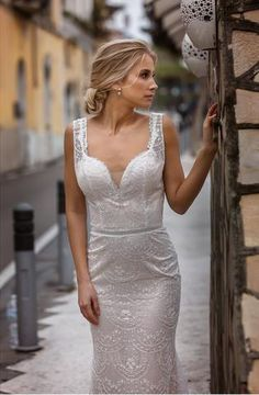 Miate is a stunning dress by Galina Couture. Beautiful fitted style, detailed and modern full lace dress with a gorgeous satin slip. The back is fastened with a hidden zip and buttons. This beautiful Miate dress is exclusively available at Luella's Bridal.