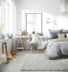 Stylish teen bedroom with a gray and white color palette.