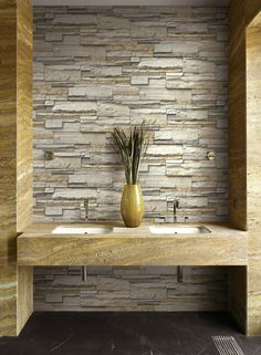 Natural stacked stone wallpaper from Wallquest's collection Structure. Industrial inspired wallpaper shown in modern bathroom