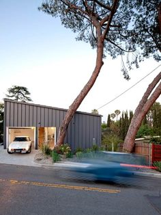 This tiny house in northeast Los Angeles by local studio Anonymous Architects contains only three rooms and is lifted off the hillside on a set of concrete pilotis.  Named BIG & small House, the two-storey residence was designed to maximise space.