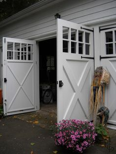 Out-swing carriage doors invite family and friends with open arms.