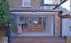A sympathetic pitched hip roof wrap around extension transformed this terraced home in Wandsworth.