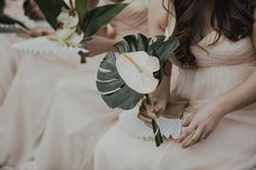tropical bridesmaid bouquet | image via: 100 layer cake
