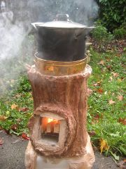 Erica Wisner has created an interesting rocket stove that looks a bit like a stump.