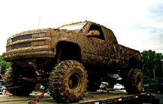 love our jacked up trucks all covered in mud