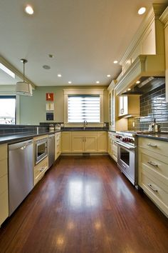 Kitchen with plenty of light, enough storage, counter space and A DISHWASHER.