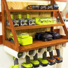 Cordless Drill Charging Station and Storage Here is a simple custom storage solution for some of your cordless drills, batteries, and chargers. Tool Wall Storage, Pvc Pipe Storage, Power Tool Storage, Diy Garage Storage, Shed Storage, Storage Rack, Storage Ideas, Storage Containers, Garage Organization Tips