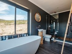 Shipping Container Homes & Buildings: Copia Eco Cabins: Two 40 ft Container Home in Bot Rivier valley by Berman-Kalil, South Africa Shipping Container Homes, Shipping Containers, Eco Cabin, Container Conversions, Off Grid Solar, Farm Cottage, Container House Design, Water Heating, Cabin Design