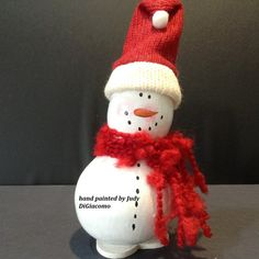 A cute little addition to your winter décor. He has a red hat and scarf to keep him warm. If you are a snowman collector, or you know