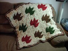 Description from pattern: This afghan portrays one of our favorite signs of fall - those spectacular rust and gold leaves. The leaf motif takes shape from specially placed squares, and simple slip stitches form the stems.