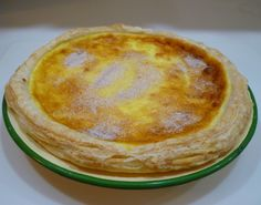 Melktert (Milk tart) is a traditional custard tart flavored with cinnamon.This popular recipe can be found in South African Cooking in the USA as well as in our e-book, Essential South African Cooking in the USA. West African Food, South African Recipes, Ethnic Recipes, African Recipe Book, Fish Recipes, Vegan Recipes, Melktert, Custard Tart, Popular Recipes