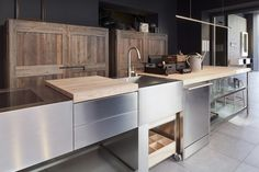 Brushed stainless steel, natural woods and industrial-grade glass - love the materials palette!