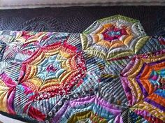 neat quilting. First spiderweb quilt that I've seen that I really like..