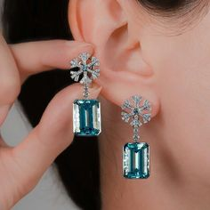 These stunning new earrings are made from 18K white gold and feature 2 emerald cut aquamarines at 17.41ct complemented by 348 diamonds and 4 aqua diamonds. Via @jewellerytheatre .