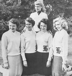 High School ladies modeling their letter sweaters