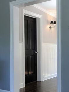 love the black doors and high wainscot