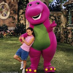 So sweet: Selena Gomez took a trip down Memory Lane on Sunday, sharing a cute Throwback snap of herself as a 7-year-old leaning up against Barney the dinosaur on the set of the PBS kids' show, Barney And Friends
