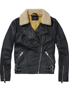 Maison Scotch Teddy Collar Leather Jacket: The Maison Scotch Teddy Collar Leather Jacket is assembled from high-quality sheep leather in a smooth finish, this leather jacket is detailed with a faux teddy trim for extra warmth and comes with zip pockets, sleeve zippers, and buckle straps at the hem. The jacket is underpinned with a printed cotton body and silky sleeve lining for the utmost comfort.
