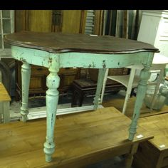 Unique antique table in old green