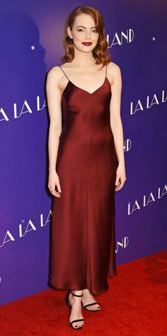Look of the Day - Emma Stone: For a screening of La La Land in London, the star went minimal  with a deep crimson slip dress by The Row that was styled with delicate jewelery by EFFY and Sara Weinstock and simple black sandals.