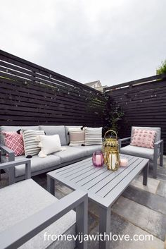 Garden Patio Area makeover, custom built black wooden privacy screen, grey slabbed area. Garden Slabs, Black Metal Chairs, Fence Lighting, Large Planters, Amazing Spaces, Outdoor Furniture Sets, Outdoor Decor, Diy Patio, Modern Spaces