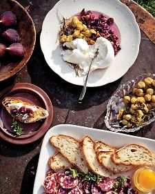 Burrata cheese, a buttery-tasting blend of mozzarella and cream, is available at Italian markets, cheese shops, and some supermarkets.