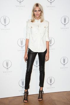 Anja Rubik in leather trousers and military style shirt at the cocktail party in celebration of Maison Vionnet's 100th Anniversary.
