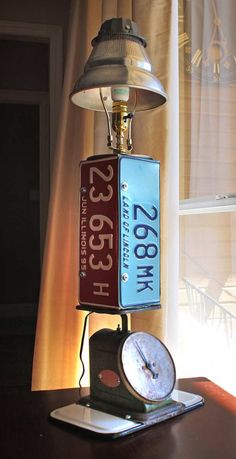 No. 5 Repurposed  Upcycled Lamp with License Plates Kitchen Postal Scale and Strainer Light Fixture of Found Objects. $225.00, via Etsy.