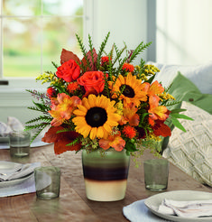 One more reason to be thankful this season, this radiant autumnal #sunflower arrangement arrives in a stunning stoneware vase with reactive glaze and distressed details, making it a favorite year-round accent piece or kitchen crock! Orange #alstroemeria, medium yellow sunflowers, orange #safflower, #solidago and brown copper beech are arranged with seeded eucalyptus, #grevillea, and #huckleberry. Delivered in Teleflora's Thankfully Yours Crock. Starting at $59.99