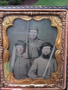 At left is Sgt. Cornelius Lawhon, killed by a cannonball at Spotsylvania Courthouse.  Standing in the center is Captain William H. Lawhon, seated at right is Major William Hogan Jones.  Captain Lawhon survived the war. Major Jones captured a Yankee flag in Virginia on August 25, 1864 and surrendered at Appomattox.  I saw this on eBay, came out of a Lawhon family estate in Moore County, NC.  All three of these men were from Moore County, NC and served in the 48th NC Infantry.