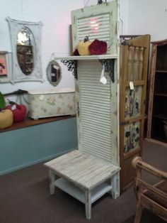 $189 - This unique shabby hall tree has been constructed from a louvered door. It has a plank seat with a lower shelf. Iron hardware for the top shelf. It's measures 27 and a half inches across the front, 22 inches deep. The height is approximately 78 inches. It can be seen in booth D 16 at Main Street Antique Mall 7260 East Main St ( E of Power Rd ) Mesa 85207  480 9241122open 7 days 10 till 530 Cash or charge 30 day layaway also available