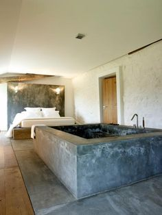 LOVE this French Basque guesthouse suite with cement tub!  Must do.