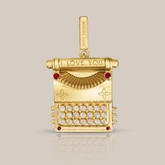 Louis Vuitton yellow gold and diamond typewriter charm. The perfect gift for a PA. I say, dearest husband, this is the perfect gift for a PA!! *hint, hint*