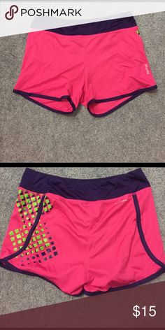 Reebok Spandex Size medium. Reebok spandex shorts. Pink with purple trim and green design on side Reebok Shorts