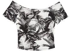 A graphic palm print lends a tropical flair to this Living Doll L.A. cropped top offering an off the shoulder design. Length is approximately 16 inches.