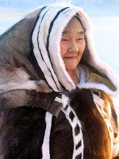 Faces of the Arctic - Inuit elder Qappik Attagutsiak in her traditional caribou and sealskin clothes.  Arctic Bay, Baffin Island, Nunavut, Canadian high Arctic