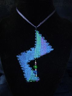 Stylish blue green zig-zag pendant with handmade bobbin lace with glass beads on a soft necklace.. $45.00, via Etsy.