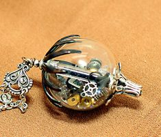 Steampunk Necklace Industrial Handblown Glass Hot Air Balloon Steampunk Style Watch Parts Moving Large Steampunk Jewelry Unisex. $49.99, via Etsy.