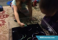 """Bioluminescence Bin - Bioluminescence is the light created and emitted by a living organism. This big scientific word can easily be explored in your sensory bin. Fill the tub with water and black washable paint (Pro-tip: do not use food coloring! It will dye your child's hands) until the water becomes murky and opaque. Then throw in some glow sticks and allow your child to go """"fishing"""" for bioluminescent organisms. Include some non-glowing """"fish"""" to extend the fun."""